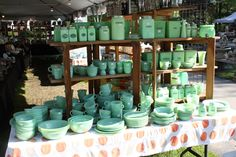"""extensive collection of Jadeite dinner and kitchenware, above. Jadeite was originally produced in the 1930′s by Mckee (you can check authenticity by looking for """"McK"""" on the bottom of any piece). Other popular makers of Jadeite include the Jeannette Glass Company and Fire-King. In the 1940′s and 50′s, the milky-green glassware was sold at hardware stores for under ten dollars. Today, they've become much more valuable and a huge collectible. One thing that differentiates jadeite from other…"""