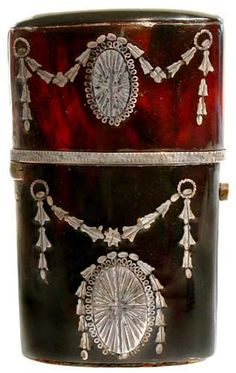 Adam style tortoiseshell silver piqué scent bottle case inlaid with oval medallions and bell flowers, 2.375in high.