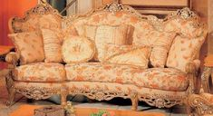 Traditional Peach Floral-Print Sofa with Ornate Wood-Carved Accents