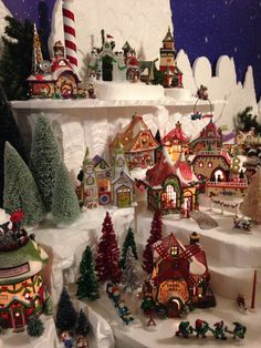 I love the Tinsel Mill with my collection of tinsel trees- Department 56 North Pole
