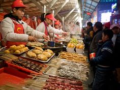 Vendors at a food market in Beijing