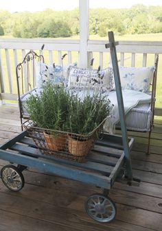 Fresh Blue Pillows for the Porch and Lavender in Baskets on Wagon | Cedar Hill Farmhouse