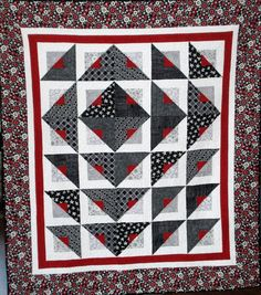 Pushing the Envelope Quilt.  Love black white and red quilts.