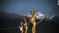 Backed by snow-capped mountains, gold-painted Dakinis -- the angels of the Buddhist world -- perch high above the capital. Himalayan snowmelt and monsoon rains power Bhutan, which is among the world& leading countries in clean energy. Thunder Dragon, Key To Happiness, Extraordinary People, Bhutan, Gold Paint, Amazing Destinations, Buddhism, The Good Place, Real Life