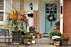 This blogger didn't let her farmhouse's lack of a full porch stop her from decorating for fall. Instead, she made good use of the space she does have by lining her steps with bundles of mums and pumpkins.  See more at Serendipity Refined.