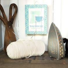 Decorating with these antique-inspired scissors and iron lamp is no chore.