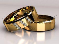 Par de alianças Ouro 18k e diamantes.