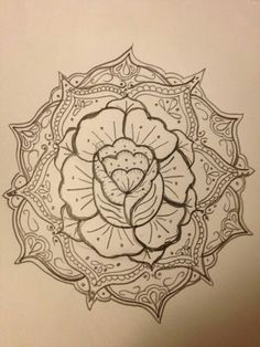 I really love the mandala art surrounding the rose. I personally would rather it be way simpler, but I like the feminine energy the rose and the mandala bring together. The spiral rose in the center & the petals blooming out.