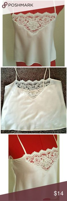 """Vtg. VS Camisole, Soft Ivory A lovely vintage Victoria's Secret cropped camisole in soft ivory. Lace inset and spaghetti style shoulder straps (not adjustable, but long enough for most. Wear as a sleep top, loungewear, or exposed under a blazer or blouse. Tagged a size Petite, measures  16.5"""" pit to pit or (33""""), 12"""" long, from underarm to hem. Vintage Intimates & Sleepwear Chemises & Slips"""