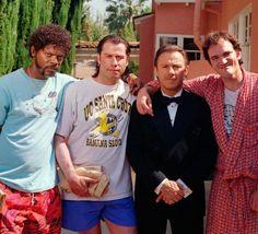 Samuel L. Jackson (Jules Winnfield), John Travolta (Vincent Vega), Harvey Keitel (Winston 'The Wolf' Wolfe) and Director/Writer Quentin Tarantino on the set of Pulp Fiction.