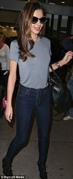 Always runway ready! A fresh-faced Miranda Kerr jets into her native Australia: