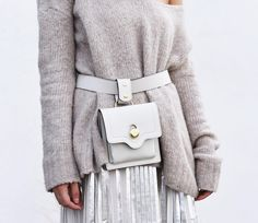 German top blogger Fashiioncarpet wears a Tory Burch belt bag mixed with a cozy jumper and silver pleats