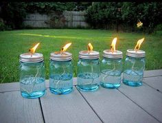 All you need is a package of Mason jars, some cotton string and some liquid citronella (find it in big jugs at any home-improvement store and even some grocery stores). Use a hammer and nail to poke a hole in the top of the lid, then pour in the citronella, put the top on and drop in the wick. Allow the string about 10 minutes to soak up some oil, then place them around your backyard and light them!