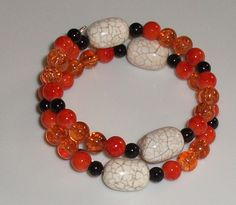 Orange, white and black memory wire bracelet