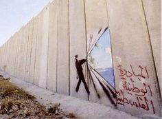 Banksy in Bethlehem: Art and The Barrier Between Two Nations | Newsflavor  British Guerrilla Artist Decorates West Bank Barrier  Photo by Marco Di Lauro on Getty Pictures