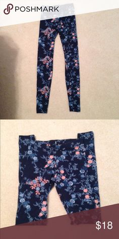 NWOT Floral Leggings This pair of leggings has never been worn. They're dark blue and pink flowers on it. It's made by Swiss designer Tally Weijl and was bought in Germany. It's too small for me unfortunately. European size 24 but very stretchy. Kept in a smoke free home. Tally Weijl Pants Leggings