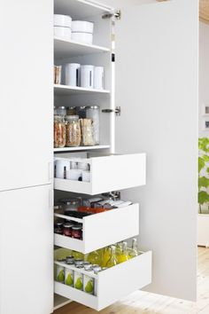 Full wall of pull-out drawers for pantry.....I wish I had this for my pantrys deep shelves