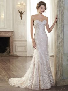 Maggie Sottero - HOLLY, Timeless romance is found in this slim A-line wedding dress featuring a delicate, sweetheart neckline and lace motifs adorning illusion tulle. Finished with covered button over zipper and inner elastic closure.