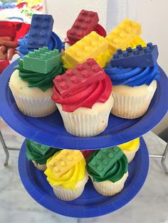 DIY edible candy Lego bricks cupcake toppers for our Lego Movie themed birthday party food. Click or visit FabEveryday.com for more photos and instructions for many Lego-themed party DIY projects
