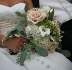 My wedding bouquet.  Roses, calla lillies and hydrangea.