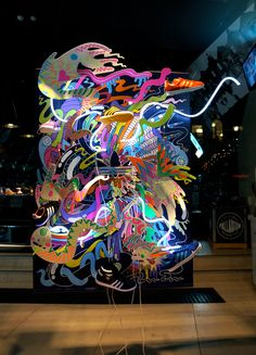 Illustrator Mimi Leung has collaborated with industrial designer Chris Ruffe to create a bright and bold window display using neon lights for Adidas Originals.