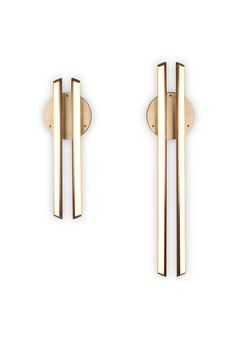 Chime 35 sconce is inspired by the harmonious sound of resonating bells. Chime 35 features two parallel bars of soft warm light floating over a disc backplate. Available in two sizes, perfect for a hallway or vanity. Contemporary Bathroom Lighting, Contemporary Light Fixtures, Modern Sconces, Contemporary Chandelier, Decorative Lighting, Contemporary Design, Overhead Lighting, Chandelier Lighting, Accent Lighting