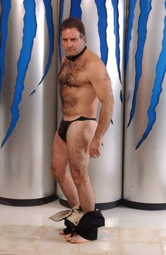 hairy bearish man removing pants taking off clothes