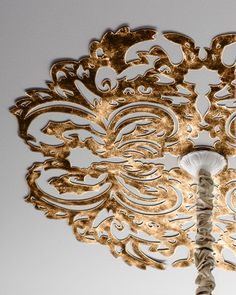 "Handcrafted ceiling medallion. Made of sheet metal. Hand-painted light burnished-gold finish. Six pre-drilled holes for attaching to ceiling; hardware not included. 32""Dia. x 0.25""D. Imported. Boxed w"