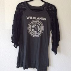 Free People tunic /tee Free People 'wildlands' graphic tee with gorgeous lace sleeves. Size medium Free People Tops Tees - Long Sleeve