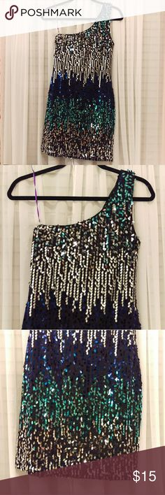 Multi Color One Shoulder Sequin Dress This dress is very beautiful for a party or a night out. No sequins are missing. No stains or damages. No zipper, fabric is stretchable. Shoulder strap is on the left. Never worn. Mid-thigh length.   Self: 93% Polyester 7% Spandex Lining: 100% Polyester As U Wish Dresses One Shoulder
