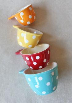 Charming Dots Measuring Cup Set 14.99 at shopruche.com. This darling set of colorful ceramic measuring cups is finished with a charming polka dot design. This stackable set looks lovely on any kitchen counter and features an orange 1/4 cup, a yellow 1/3 cup, a red 1/2 cup and a blue 1 cup...
