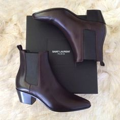 "Yves Saint Laurent Wyatt Rock Chelsea Boots 37 Excellent condition Saint Laurent Chelsea boots. Size 37. Same as US size 6. Narrow fit. Slip on style with elastic gore detail. Heel height 1.5"". Brownish black color. Almost black. Leather insole and sole.  Retail price $1100. Pointed toe shape. Ankle pull tab. Calfskin leather. Only worn 3 times. Leg opening 8"", width of sole 3"", length of sole 9.5"". ❌No PayPal. ❌No trade. ❌ No low offers. ❌ Saint Laurent Shoes"