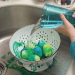 Tie-Dye Easter Eggs... super easy!  Just place hard-boiled eggs in a colander in the sink, splash with vinegar, and drip food coloring on top!! I think I'm going to do this with my girls this year!