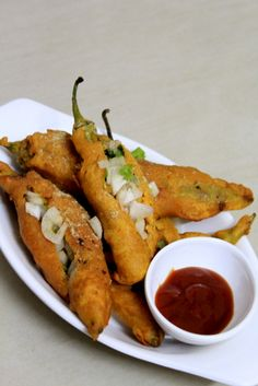 Mirchi bajji is a popular street side snack mostly found in the streets of south india or andhra regions. The mirapakaya bajji is an all time favorite snack Indian Appetizers, Indian Snacks, Indian Food Recipes, Comida India, Snack Recipes, Cooking Recipes, Cooking Tips, Vegan Recipes, Chaat Recipe
