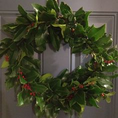Cut branches from a holly bush and make this festive (Free) holiday wreath... By attaching the holly with wire and a form made from sticks. It's much easier than it looks! Try it with things found around your house, for free holiday decor.