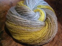 Finest baby alpaca fibers gradiently dyed from pale to soft baby blue and turquoise and ending up in warm yellow. It was then spun on my beautiful