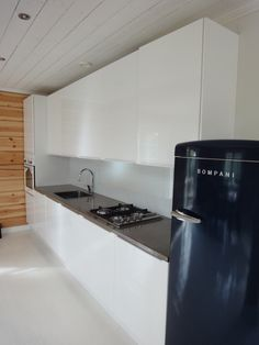 Concrete countertop by me  #Concrete #Countertop #White #Kitchen #Blue #Fridge #Smeg