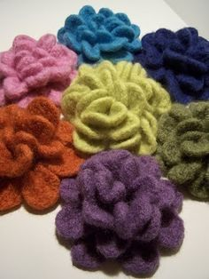Crochet Felted Flowers Brooche  PATTERN.  Available on Etsy.  http://www.etsy.com/listing/93647949/crochet-felted-flowers-brooche-pattern#