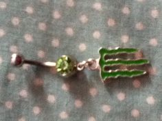 Green monster belly ring made of surgical steel.