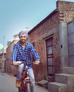 Diljit-Dosanjh-Riding-Bicycle.jpg 768×960 pixels