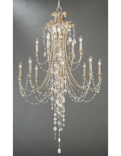 Vaxcel's Anastasia Collection features a silver leaf foil finish and natural shell embellishments. TM 3942. www.vaxcel.com
