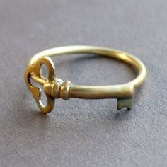Ring shaped like a key that wraps around finger