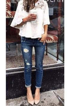 White peasant top, distressed skinny jeans, pumps. Love.