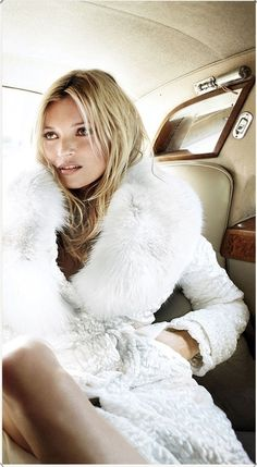 Kate Moss wearing a glorious white coat by Tom Ford.