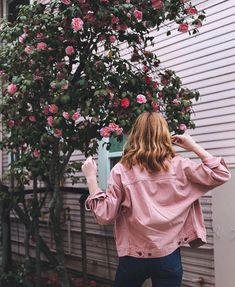 Dancing in the flowers with cute pink jacket