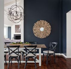 Good article on dark walls - works with lots of light, white trim and bold feature on the wall. What about painting a brick thermal mass wall black or charcoal? Beach Style Dining Room by Corine Maggio Natural Designs