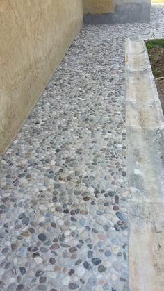 Pavimento in ciottoli di fiume meix per un pavimento da esterno ricercato dal design rustico..