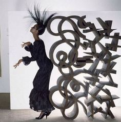 Iman in a Mary McFadden dress, posing with a Lucas Samaras' sculpture @ Lannan Foundation, Palm Beach _ Photo by Norman Parkinson, Town & Country Magazine, 1982.