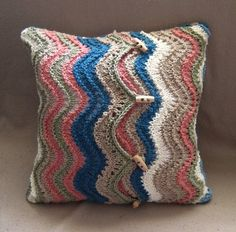 Knitted ripple cushion cover. Must try this one.