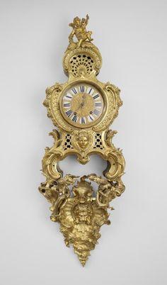 Case by Charles Cressent (1685−1768) Movement by Jean-Baptiste Delaroche (dates unknown) Spring-Driven Pendulum Clock on a Bracket Paris, c. 1735 Gilt bronze, enameled metal, and glass 44 1/2 in. high x 18 1/8 in. wide